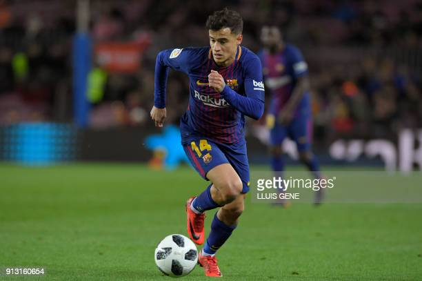 Barcelona's Brazilian midfielder Philippe Coutinho controls the ball during the Spanish 'Copa del Rey' first leg semifinal football match between FC...