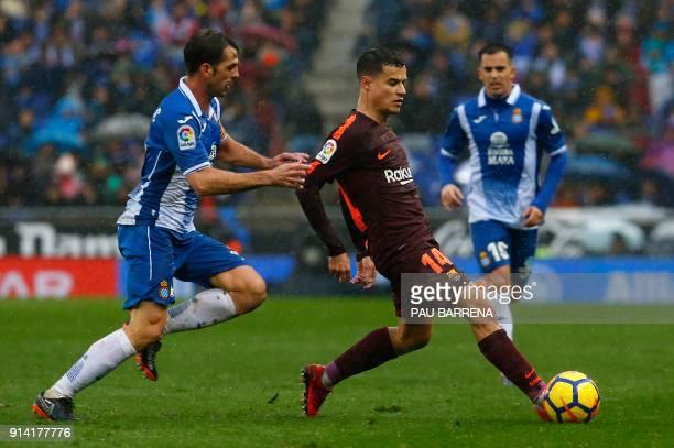 Barcelona's Brazilian midfielder Philippe Coutinho Espanyol's Spanish midfielder Victor Sanchez during the Spanish league football match between RCD...