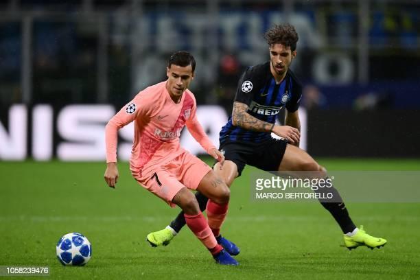 Barcelona's Brazilian midfielder Philippe Coutinho holds off Inter Milan's Croatian defender Sime Vrsaljko during the UEFA Champions League group B...