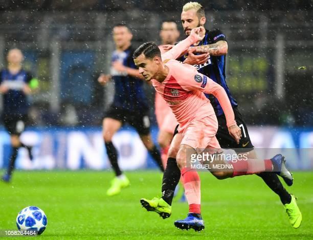 Barcelona's Brazilian midfielder Philippe Coutinho outruns Inter Milan's Croatian midfielder Marcelo Brozovic during the UEFA Champions League group...