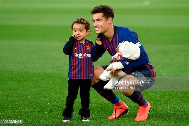 Barcelona's Brazilian midfielder Philippe Coutinho poses with his children before the Spanish league football match FC Barcelona against Valencia CF...