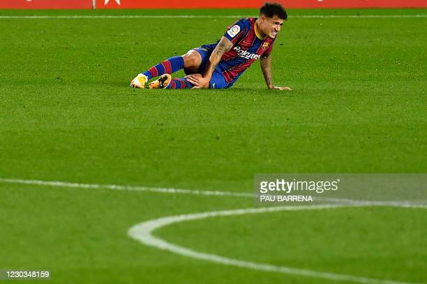 Barcelona's Brazilian midfielder Philippe Coutinho reacts after falling during the Spanish League football match between Barcelona and Eibar at the...