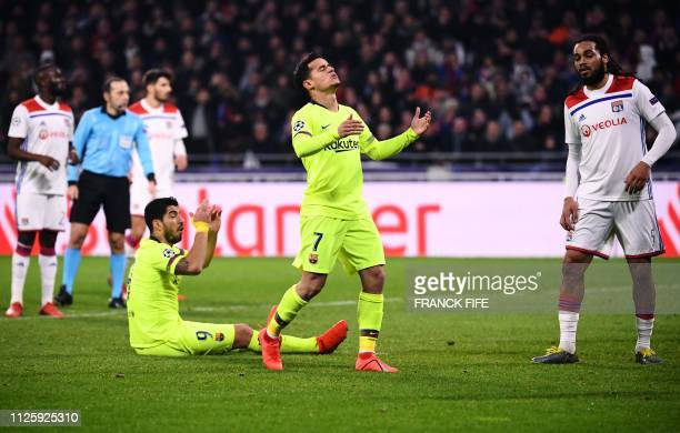 Barcelona's Brazilian midfielder Philippe Coutinho reacts next to Barcelona's Uruguayan forward Luis Suarez during the UEFA Champions League round of...