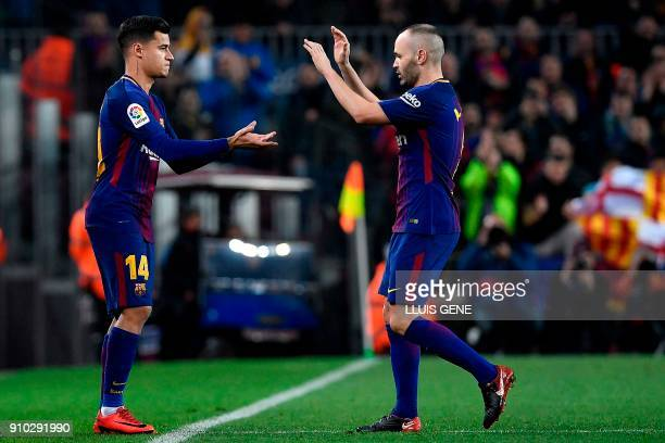 Barcelona's Brazilian midfielder Philippe Coutinho replaces Barcelona's Spanish midfielder Andres Iniesta during the Spanish 'Copa del Rey'...
