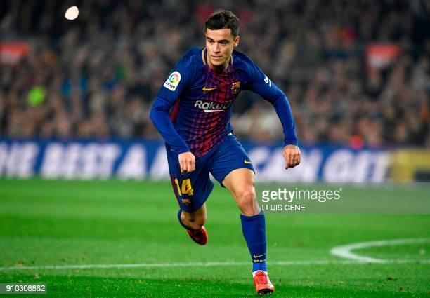 Barcelona's Brazilian midfielder Philippe Coutinho runs during the Spanish 'Copa del Rey' quarterfinal second leg football match between FC Barcelona...