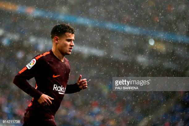 Barcelona's Brazilian midfielder Philippe Coutinho runs during the Spanish league football match between RCD Espanyol and FC Barcelona at the RCDE...