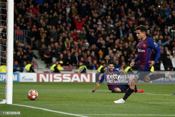 Barcelona's Brazilian midfielder Philippe Coutinho scores a goal during the UEFA Champions League round of 16 second leg football match between FC...