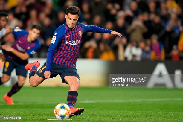 Barcelona's Brazilian midfielder Philippe Coutinho scores a penaly kick during the Spanish Copa del Rey quarter-final second leg football match...