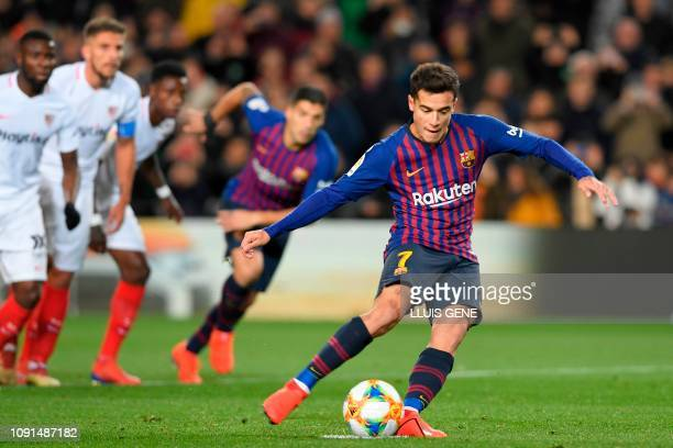 Barcelona's Brazilian midfielder Philippe Coutinho scores a penaly kick during the Spanish Copa del Rey quarterfinal second leg football match...