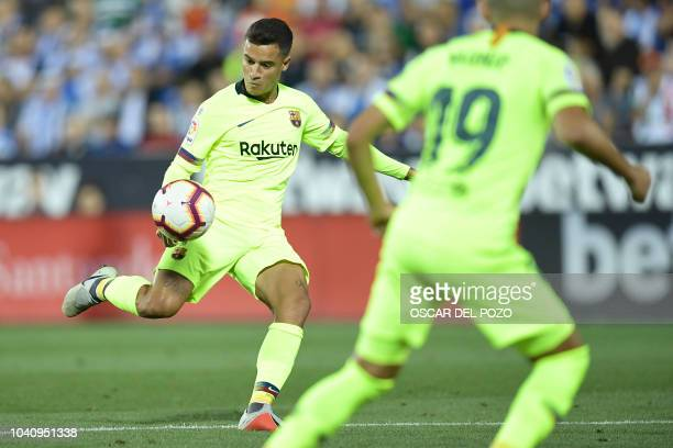 Barcelona's Brazilian midfielder Philippe Coutinho shoots to score the opening goal during the Spanish league football match Club Deportivo Leganes...