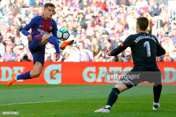 Barcelona's Brazilian midfielder Philippe Coutinho vies with Athletic Bilbao's Spanish goalkeeper Kepa Arrizabalaga Revuelta during the Spanish...