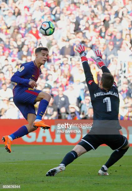 Barcelona's Brazilian midfielder Philippe Coutinho vies with Athletic Bilbao's Spanish goalkeeper Kepa Arrizabalaga Revuelta during the Spanish...
