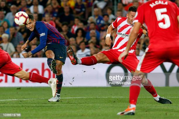 Barcelona's Brazilian midfielder Philippe Coutinho vies with Girona's Spanish midfielder Alex Granell during the Spanish league football match...