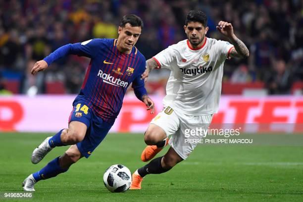 Barcelona's Brazilian midfielder Philippe Coutinho vies with Sevilla's Argentinian midfielder Ever Banega during the Spanish Copa del Rey final...