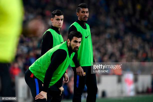 Barcelona's Brazilian midfielder Philippe Coutinho warms up with Barcelona's Portuguese midfielder Andre Gomes and Barcelona's Brazilian midfielder...