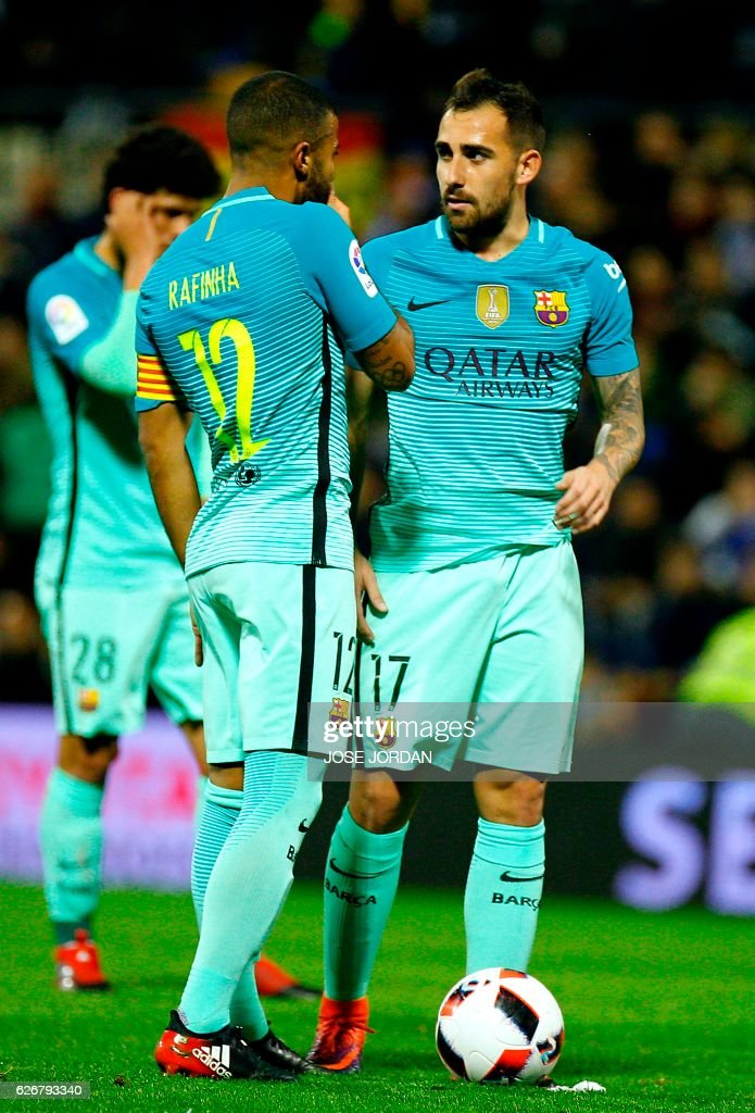 Barcelona's Brazilian midfielder Rafinha (L) speaks with Barcelona's forward Paco Alcacer during the Spanish Copa del Rey (King's Cup) round of 32 first leg football match Hercules CF vs FC Barcelona at the Estadio Jose Rico Perez in Alicante on November 30, 2016. /