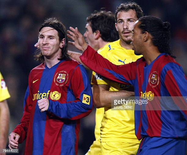 FC Barcelona's Brazilian player Ronaldinho gestures to teammate Leo Messi after missing a penalty during a Spanish King's Cup championship football...