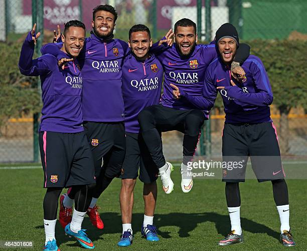 Barcelona's Brazilian players Adriano Rafael Douglas Dani Alves and Neymar pose during the FC Barcelona training session at Ciutat Esportiva on...