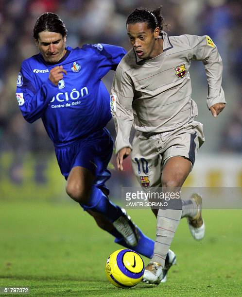 Barcelona's Brazilian Ronaldinho fights for the ball with Getafe's Sergio Pachon during their Spanish Premier League football match at Alfonso Perez...