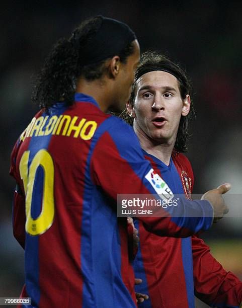Barcelona's Brazilian Ronaldinho talks with Argentinian teammate Leo Messi during a Spanish League football match against Levante at the Camp Nou...