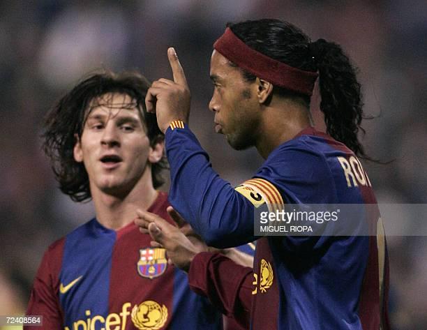Barcelonas Brazilian Ronaldo de Assis Ronaldinho celebrates with teammate Argentine Lionel Messi after scoring against Deportivo Coruna's during...
