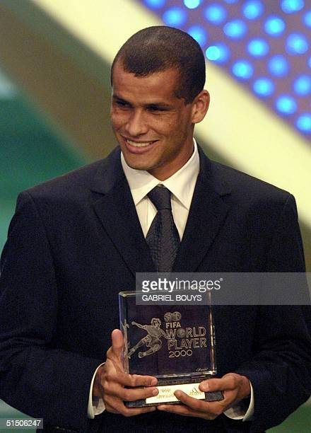 """Barcelona's Brazilian striker Rivaldo holds his trophy of FIFA's """"Third World footballer of the year"""" 11 December 2000, during the ceremony gala in..."""
