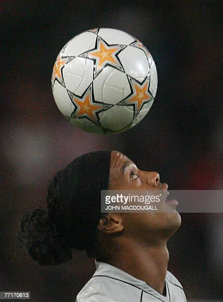 Barcelona's Brazilian striker Ronaldinho warms up with the ball prior to the VfB Stuttgart vs FC Barcelona group E Champions League football match in...