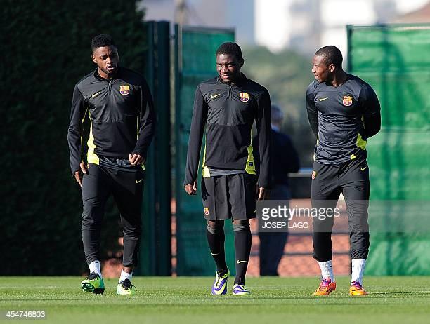 Barcelona's Cameroonian midfielder Alexandre Song Barcelona's Cameroonian forward JeanMarie Dongou and Barcelona's forward Adama Traore Diarra take...