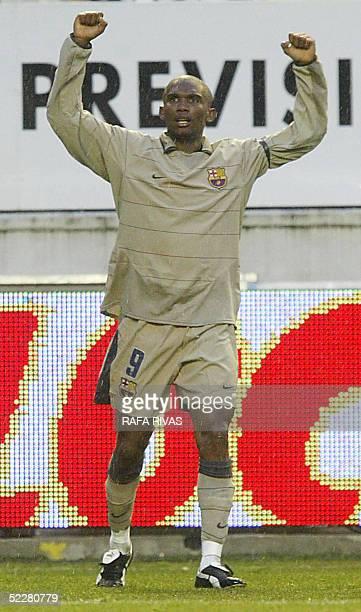 Barcelona's Cameroonian Samuel Etoo celebrates his goal 05 March 2005 during a Spanish league football match against Osasuna at the Sadar stadium in...