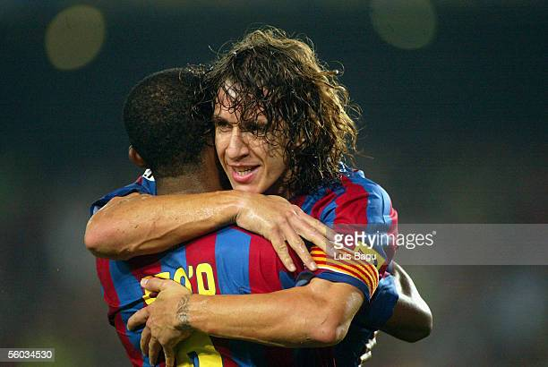 Barcelona's captain Carles Puyol celebrates his goal with Samuel Etoo during the La Liga match between FC Barcelona and Real Sociedad on October 30...