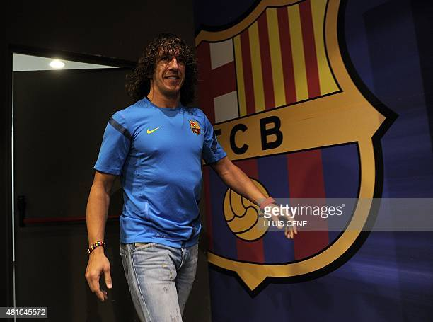 Barcelona's captain Carles Puyol gives a press conference on April 2 2012 at the Camp Nou stadium in Barcelona on the eve of their Champions League...