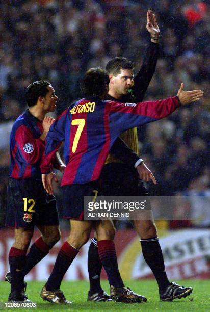 Barcelona's captain Sergi and Alfonso plead with referee Terje Hauge after Barcelona had a goal disallowed during the second half of the Champions...
