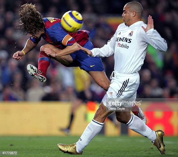 Barcelona's Carles Pujol intercepts Real Madrid's Ronaldo during their la Liga match at Nou Camp on November 20 2004 in Barcelona Spain
