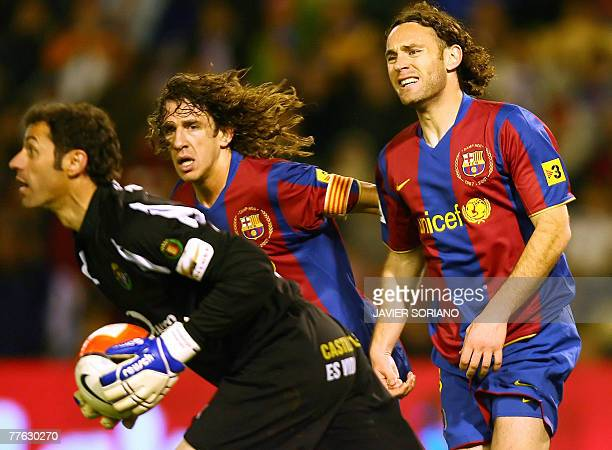 Barcelona's Carles Puyol and Gabi Milito look dejected after mising a goal to Valladolid's goalkeeper Alberto Lpez during a Spanish league football...