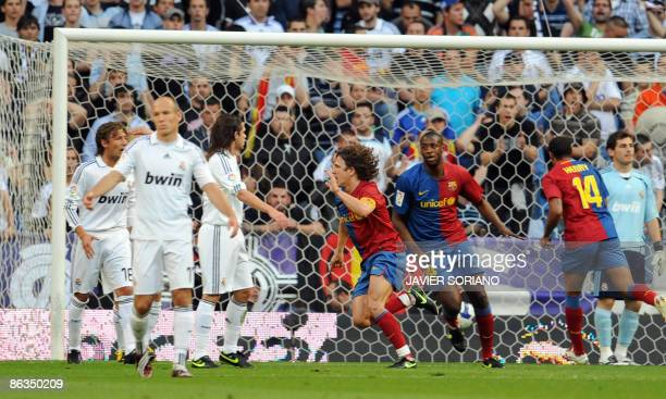 Barcelona's Carles Puyol celebrates after scoring his team's second goal against Real Madrid during their Spanish league football match at Santiago...