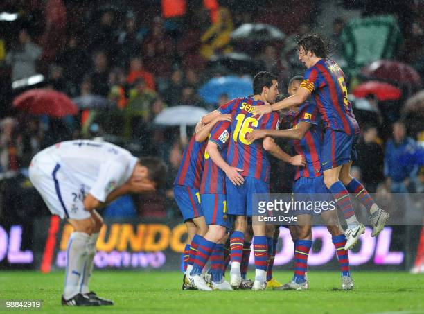 Barcelona's Carles Puyol celebrates with teammates after Pedro Rodriguez scored Barcelona's third goal during the La Liga match between Barcelona and...