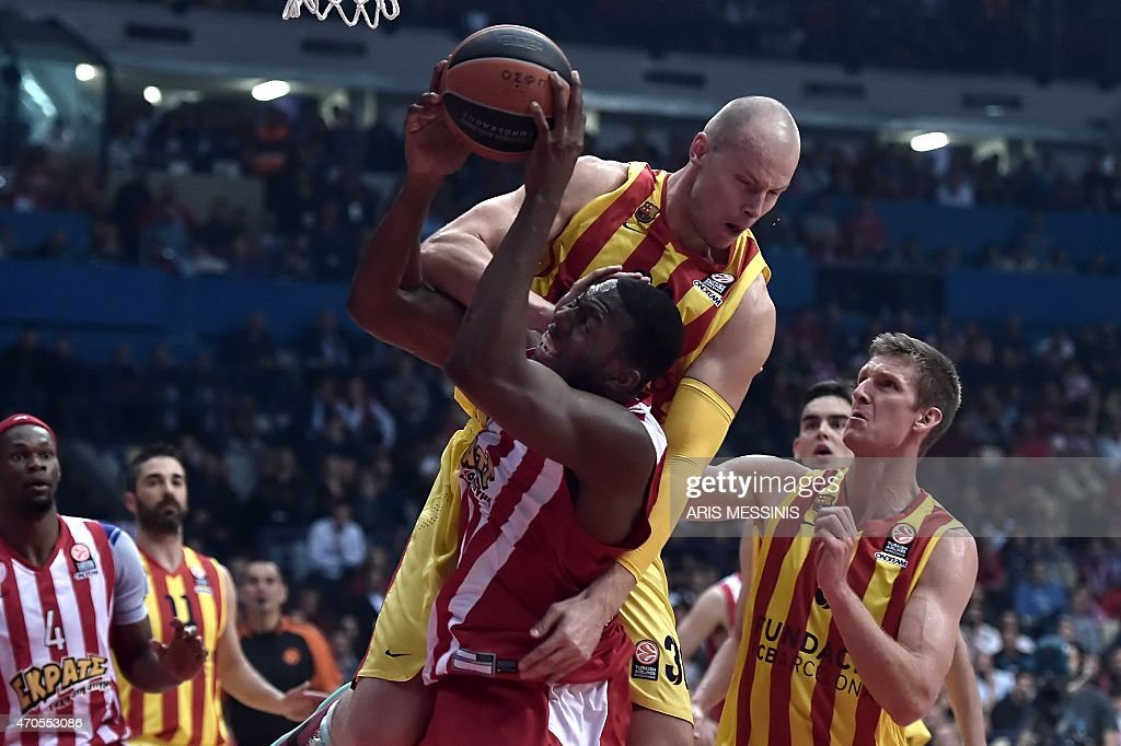 Barcelonau0027s Center Maciej Lampe (Top) Blocks A Field Goal Attempt By  Olympiakosu0027 Center