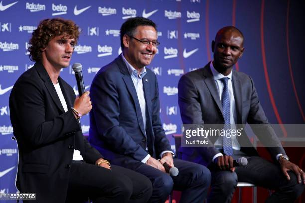 FC Barcelona's Chairman Josep Maria Bartomeu Barcelona's new sign French star Antoine Griezmann and Barcelona's former player Eric Abidal attend the...