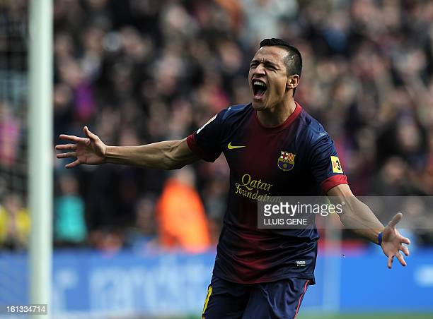 Barcelona's Chilean forward Alexis Sanchez celebrates after scoring during the Spanish league football match FC Barcelona vs Getafe at the Camp Nou...
