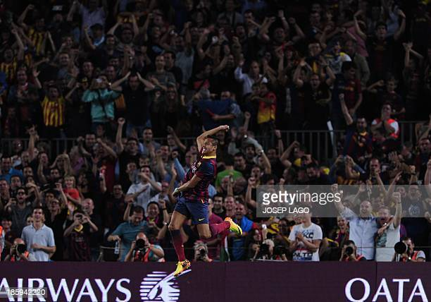 Barcelona's Chilean forward Alexis Sanchez celebrates after scoring during the Spanish league Clasico football match FC Barcelona vs Real Madrid CF...