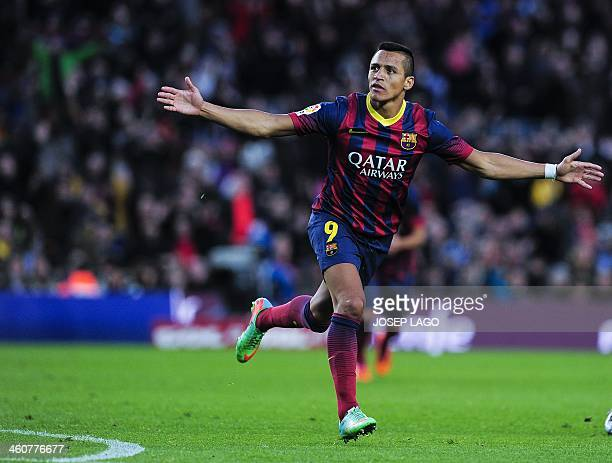Barcelona's Chilean forward Alexis Sanchez celebrates after scoring during the Spanish league football match FC Barcelona vs Elche CF at the Camp Nou...