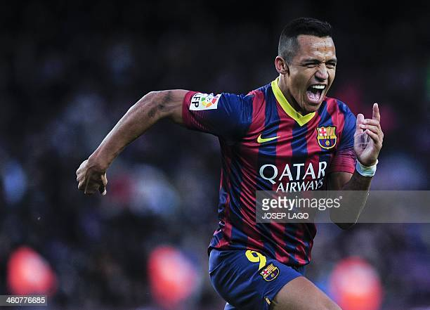 Barcelona's Chilean forward Alexis Sanchez celebrates after scoring his third goal during the Spanish league football match FC Barcelona vs Elche CF...