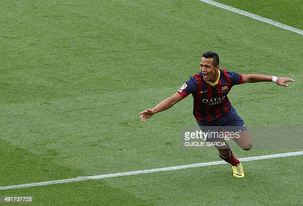 Barcelona's Chilean forward Alexis Sanchez celebrates after scoring during the Spanish league football match FC Barcelona vs Club Atletico de Madrid...
