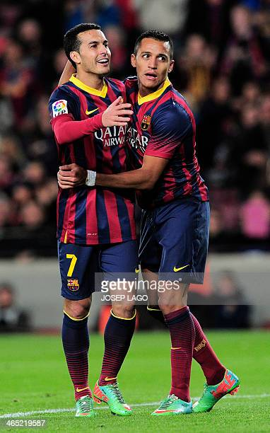 Barcelona's Chilean forward Alexis Sanchez is congratulated by his teammate Barcelona's forward Pedro Rodriguez after scoring during the Spanish...