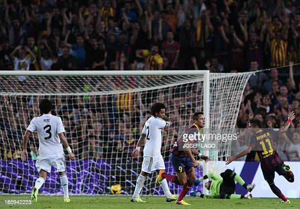 Barcelona's Chilean forward Alexis Sanchez scores during the Spanish league Clasico football match FC Barcelona vs Real Madrid CF at the Camp Nou...