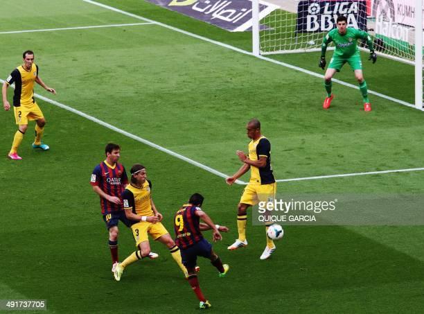 Barcelona's Chilean forward Alexis Sanchez scores during the Spanish league football match FC Barcelona vs Club Atletico de Madrid at the Camp Nou...
