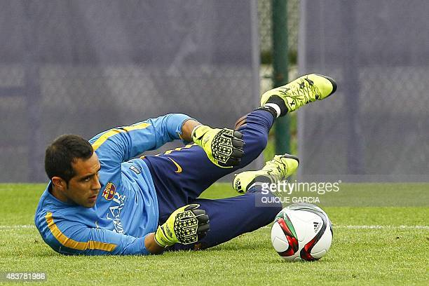 Barcelona's Chilean goalkeeper Claudio Bravo takes part in a training session at the Sports Center FC Barcelona Joan Gamper in Sant Joan Despi, near...