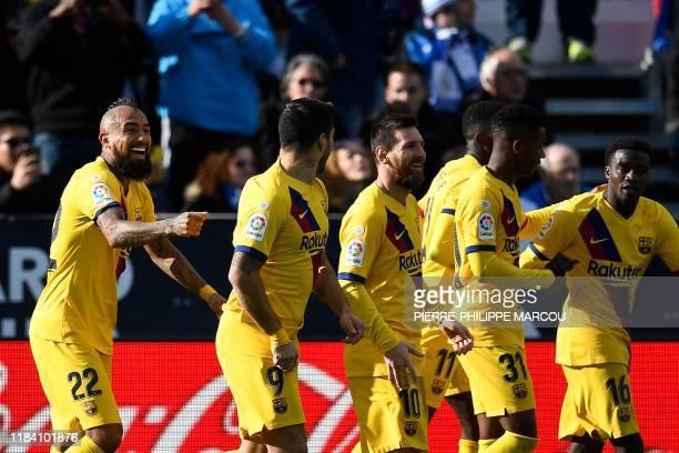 Barcelona's Chilean midfielder Arturo Vidal celebrates after scoring during the Spanish league football match Club Deportivo Leganes SAD against FC...