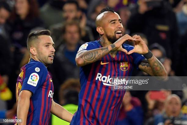 Barcelona's Chilean midfielder Arturo Vidal celebrates scoring Barcelona's fifth goal during the Spanish league football match between FC Barcelona...