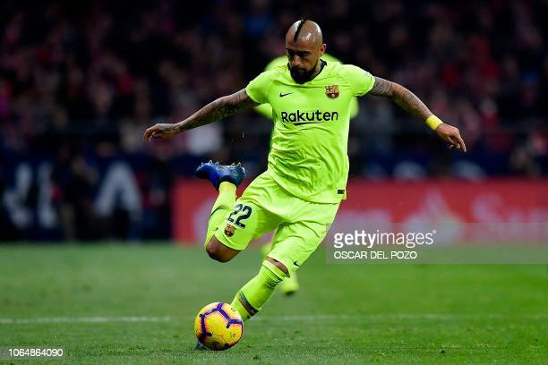 Barcelona's Chilean midfielder Arturo Vidal controls the ball during the Spanish league football match between Club Atletico de Madrid and FC...